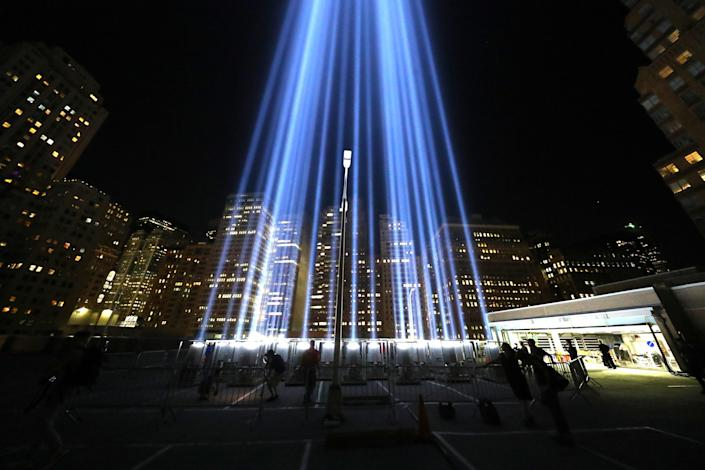 <p>The Tribute in Light beams up into the New York City skyline from the rooftop of a garage in lower Manhattan on Sept. 5, 2018. (Photo: Gordon Donovan/Yahoo News) </p>