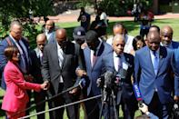 Members of the George Floyd family (from 4thL-R) George Floyd's brothers Philonise and Terrence, nephew Brandon Williams, Reverend Al Sharpton, civil rights lawyer and lead attorney for the George Floyd family Benjamin Crump, and Floyd's brother Rodney pray following the sentencing of former Minneapolis police officer Derek Chauvin, outside the Hennepin County Government Center on June 25, 2021 in Minneapolis, Minnesota