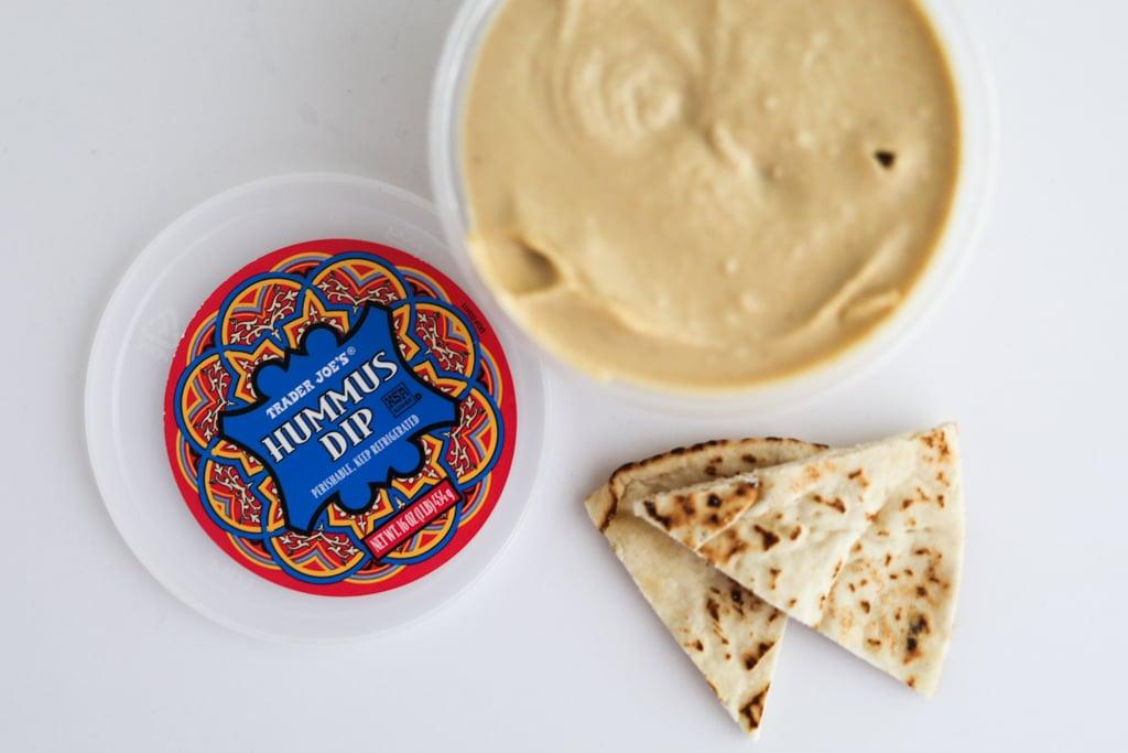 <p>Ah, the classic Trader Joe's Hummus Dip. There's nothing really negative to say about this one. It checks off all the boxes and it comes in a large 16-ounce container so you can dip to your heart's desire. If you're looking for a traditional hummus dip, this is the one for you.</p>