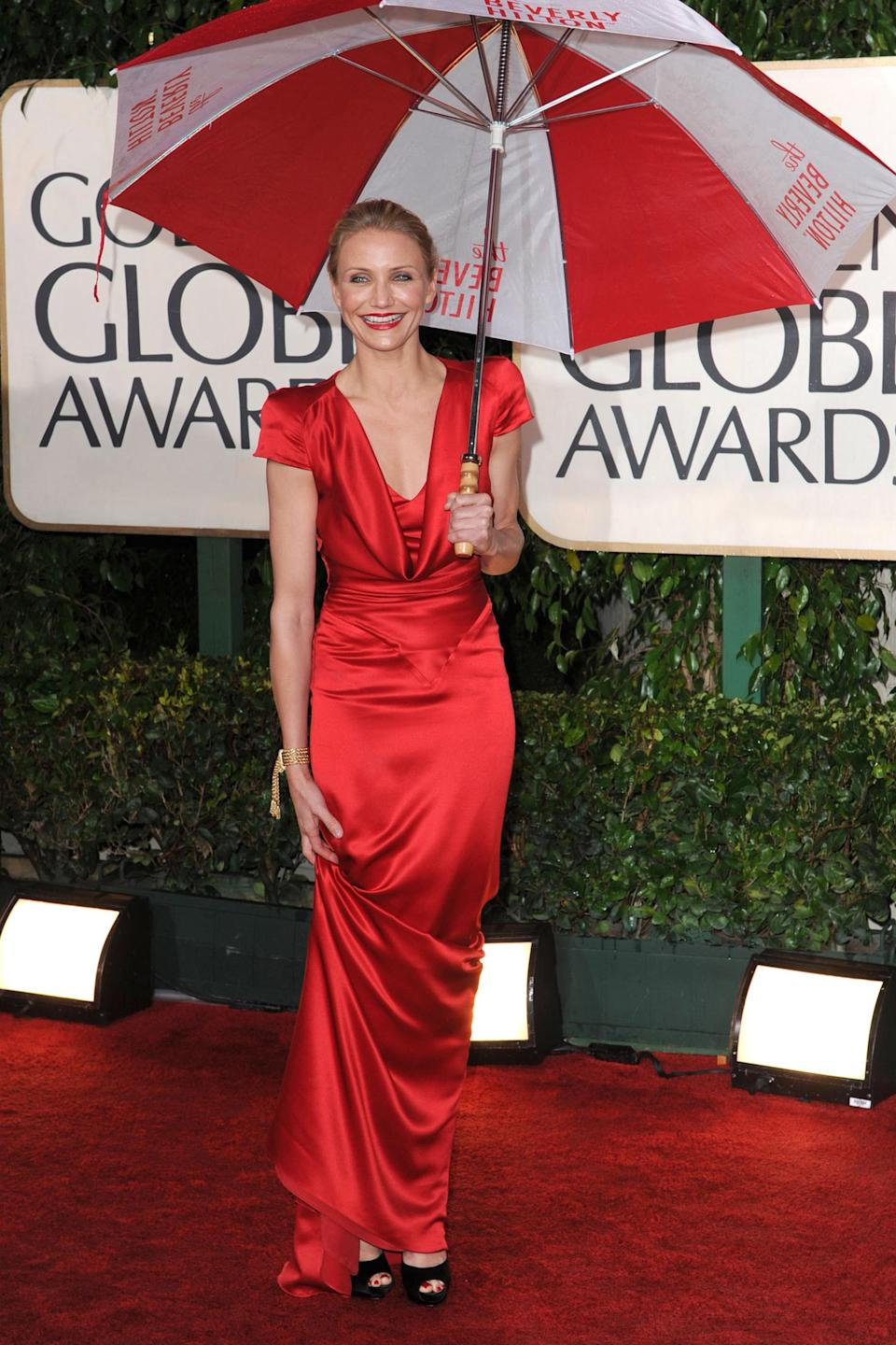 """<strong><h2>2010</h2></strong><br>A few showers couldn't stop Cameron Diaz (and that dazzling smile) from showing up her competition in this drapey Alexander McQueen gown.<br><br><em>Cameron Diaz in Alexander McQueen.</em><span class=""""copyright"""">Photo: SGranitz/WireImage.</span>"""