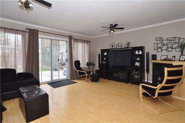 <p><span>124 Eastwood Ave., Toronto, Ont.</span><br> The family room has a gas fireplace, and a walk-out to the backyard.<br> (Photo: Zoocasa) </p>