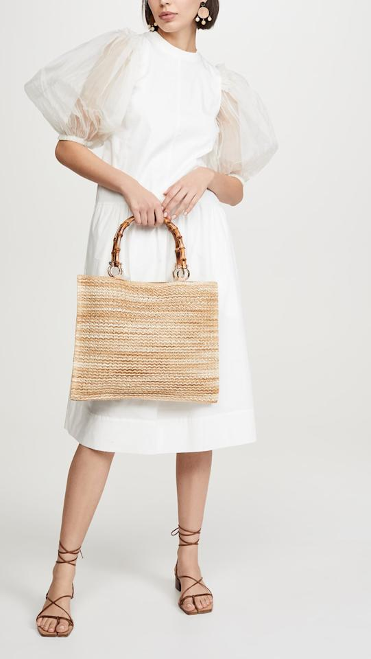 "<p>Get this <a href=""https://www.popsugar.com/buy/Caterina-Bertini-Bamboo-Handle-Tote-Bag-555344?p_name=Caterina%20Bertini%20Bamboo%20Handle%20Tote%20Bag&retailer=shopbop.com&pid=555344&price=155&evar1=fab%3Aus&evar9=47293844&evar98=https%3A%2F%2Fwww.popsugar.com%2Ffashion%2Fphoto-gallery%2F47293844%2Fimage%2F47293855%2FCaterina-Bertini-Bamboo-Handle-Tote-Bag&list1=shopping%2Caccessories%2Cbags%2Cspring%2Cspring%20fashion%2Cfashion%20shopping&prop13=mobile&pdata=1"" rel=""nofollow"" data-shoppable-link=""1"" target=""_blank"" class=""ga-track"" data-ga-category=""Related"" data-ga-label=""https://www.shopbop.com/bamboo-handle-tote-caterina-bertini/vp/v=1/1566601951.htm?folderID=13505&amp;fm=other-viewall&amp;os=false&amp;colorId=12688&amp;ref=SB_PLP_NB_97"" data-ga-action=""In-Line Links"">Caterina Bertini Bamboo Handle Tote Bag</a> ($155) for your next vacation.</p>"