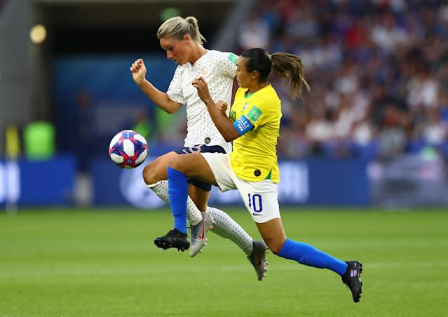 Amandine Henry of France battles for possession with Marta of Brazil during the 2019 FIFA Women's World Cup France Round Of 16 match between France and Brazil at Stade Oceane on June 23, 2019 in Le Havre, France. (Photo by Martin Rose/Getty Images)