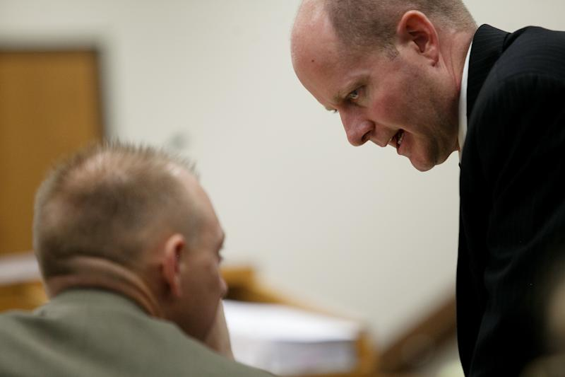 Chad Grunander, Utah County prosecutor, right, speaks to Sam Pead, fellow Utah County prosecutor, during the trial of Martin MacNeill at the Fourth District Court in Provo Wednesday, Oct. 30, 2013. MacNeill is charged with murder for allegedly killing his wife Michele MacNeill in 2007. (AP Photo/Daily Herald, Mark Johnston, Pool)