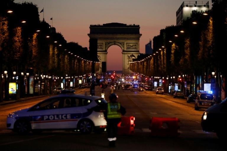 Police officers block the Champs Elysees boulevard in Paris after a shooting that left one police officer dead and another wounded on April 20, 2017