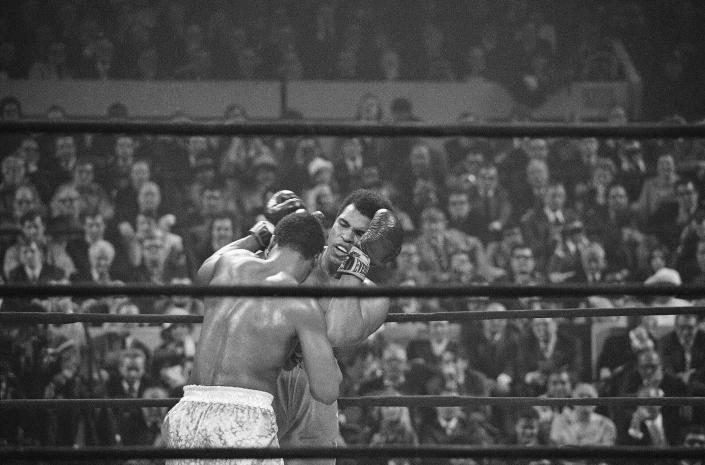 FILE - In this March 8, 1971 file photo, Joe Frazier, left, faces off against Muhammad Ali, right, on the ropes during the fourth round of their heavyweight title bout in New York. It wasn't just a fight, but a political and sociological event. Ali was loved by many but despised by many more for his mouth, his refusal to be inducted in the Army and his Muslim religion. Frazier was his foil, a working man's heavyweight labeled an ``Uncle Tom'' by Ali because a lot of white Americans were cheering for him to win. (AP Photo/File)