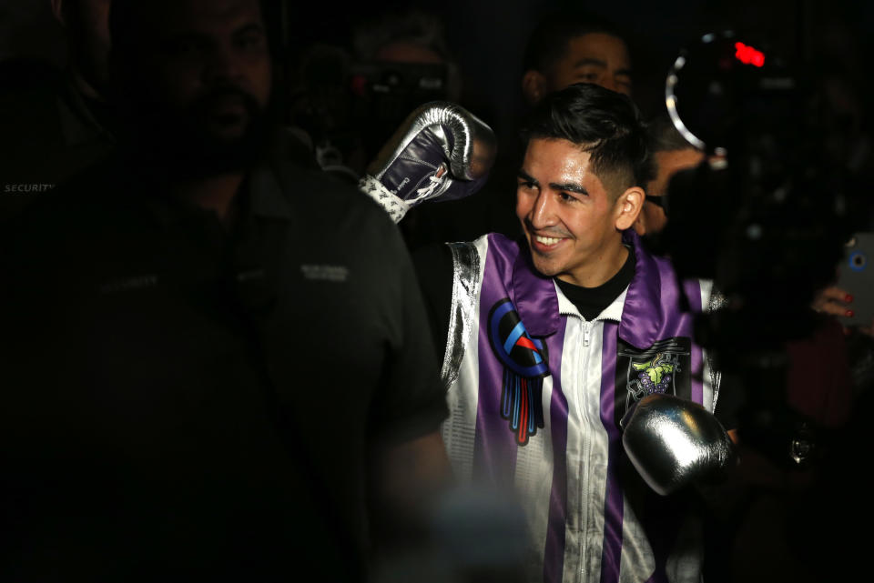 LAS VEGAS, NEVADA - NOVEMBER 23:  Leo Santa Cruz makes his entrance to the ring for the vacant WBA super featherweight title fight against Miguel Flores at MGM Grand Garden Arena on November 23, 2019 in Las Vegas, Nevada.   (Photo by Steve Marcus/Getty Images)