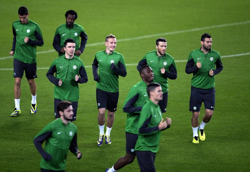 Celtic players take part in a training session at Camp Nou in Barcelona on December 10, 2013