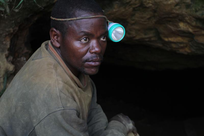 In this photo taken Aug. 17, 2012 photo, a man who used to earn a living mining cassiterite, the major ore of tin, poses for a portrait at the entrance to a mine shaft, at the largely-abandoned Nyabibwe mine, in eastern Congo. Gold is now the primary source of income for armed groups in eastern Congo, and is ending up in jewelry stores across the world, according to a report published Thursday, Oct. 25, 2012, by the Enough Project. Following American legislation requiring companies to track the origin of the minerals they use, armed groups have been unable to profit from the exploitation of tin, tungsten, and tantalum, and have turned instead to gold, which is easier to smuggle across borders. Gold miners, like cassiterite miners, work in extreme conditions, with crude equipment such as pick-axes and shovels. (AP Photo/Marc Hofer)