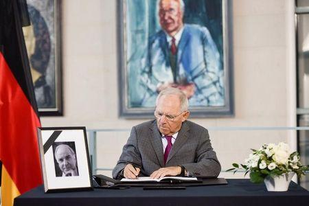German Finance Minister Wolfgang Schaeuble writes a message in a book of condolence for former chancellor Helmut Kohl at the Chancellery in Berlin, Germany June 21, 2017. REUTERS/Stefanie Loos/Files