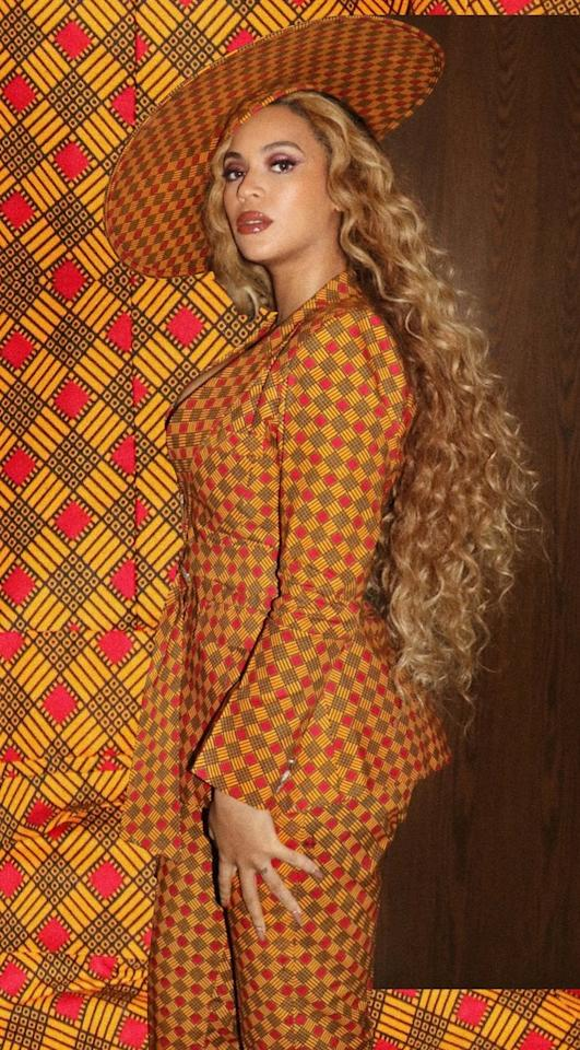 """<p>Beyoncé attended the opening of DREAMWEAVERS, an exhibit co-presented in Los Angeles by Swizz Beatz and UTA Artist Space, wearing an outfit that effortlessly complemented the rest of the artwork. Her <a href=""""https://www.popsugar.com/fashion/Beyonce-Wears-Ankara-Suit-Art-Show-2019-45802141"""" class=""""ga-track"""" data-ga-category=""""Related"""" data-ga-label=""""https://www.popsugar.com/fashion/Beyonce-Wears-Ankara-Suit-Art-Show-2019-45802141"""" data-ga-action=""""In-Line Links"""">brightly colored pantsuit</a> featured a low-cut front with a tasteful tie waist and intricate pattern. She finished off her look with a pair of strappy Jimmy Choo sandals and a fashion-forward hat.</p>"""