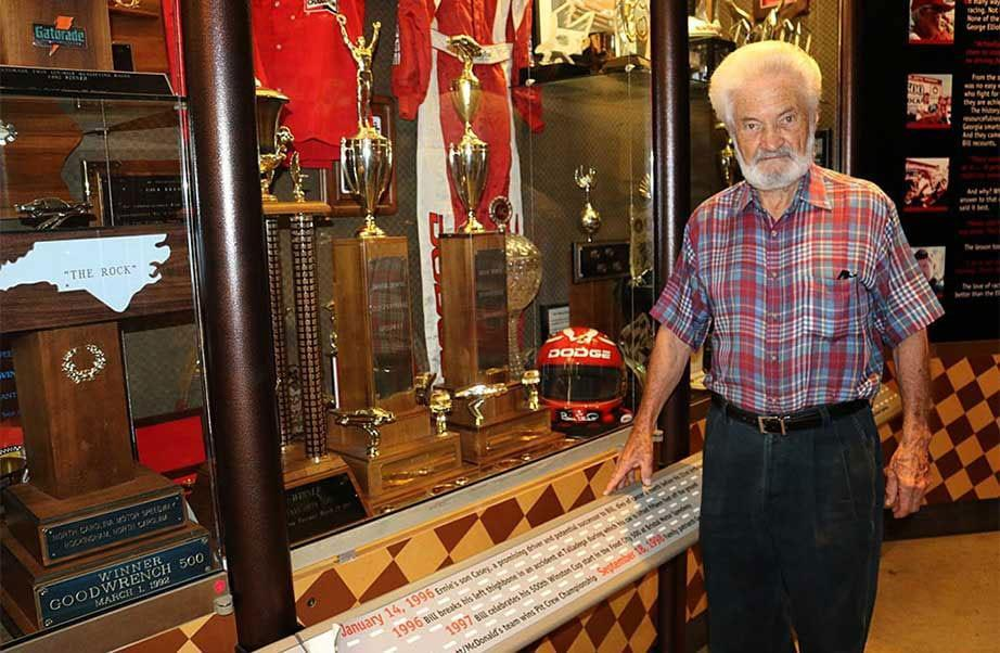 Gordon Pirkle Sr. stands in front of a display