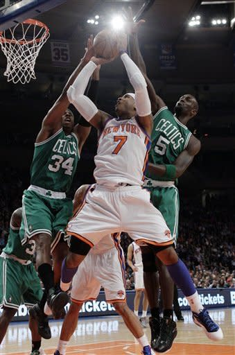 Boston Celtics' Paul Pierce (34) and teammate Kevin Garnett (5) defend New York Knicks' Carmelo Anthony (7) during the first half of an NBA basketball game Tuesday, April 17, 2012, in New York. (AP Photo/Frank Franklin II)