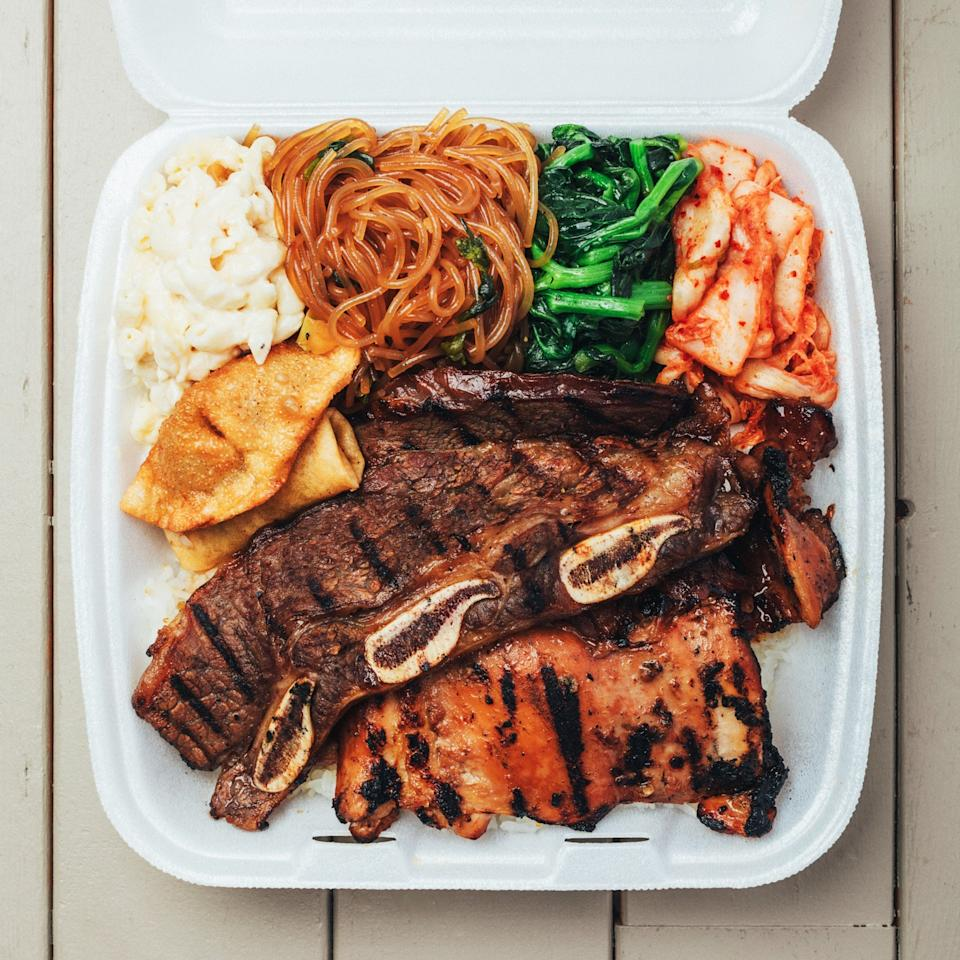 "A plate lunch conjures different carb-loaded memories for every local—maybe craggy mochiko chicken with a scoop each of rice and mac salad, or fat-rimmed kalbi with, yup, rice and mac salad. For me it's the latter and my favorite is at <a href=""https://www.facebook.com/pages/Ginas-Barbeque/117180721635008"" rel=""nofollow"" target=""_blank"">Gina's BBQ</a>. The grilled short ribs are charred in the right spots and come not only with the requisite scoops but also house-made kimchi and sesame-oil-slicked japchae."
