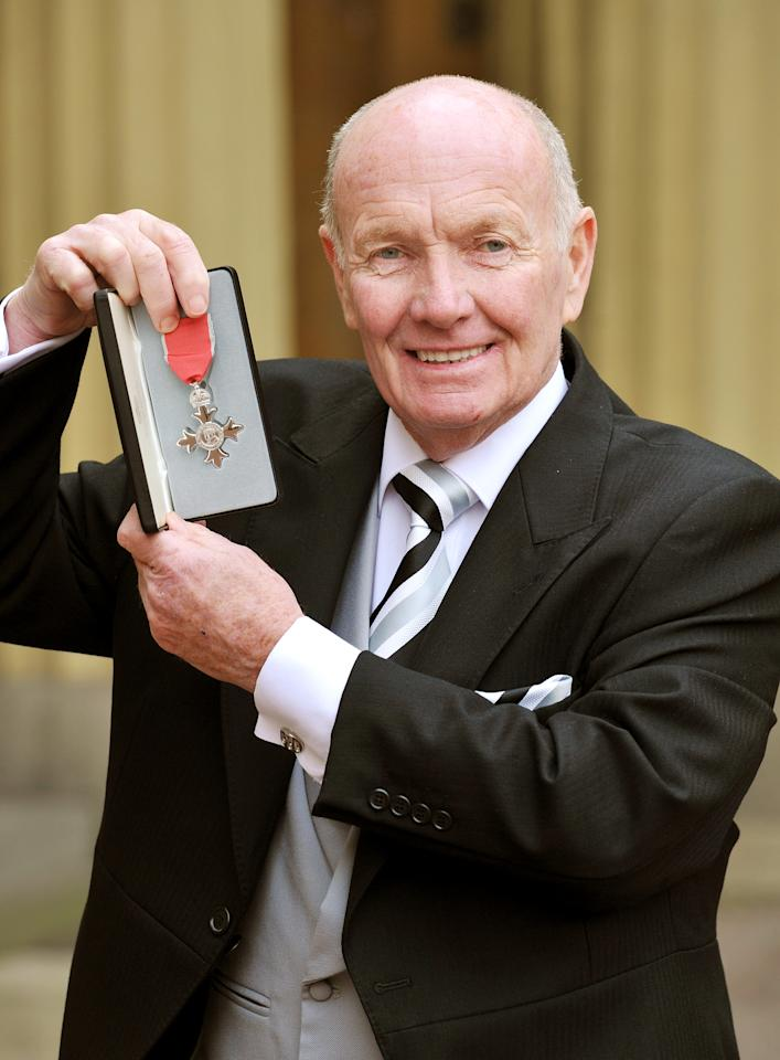LONDON, UNITED KINGDOM - DECEMBER 6:  Cricket umpire Jack Birkenshaw poses after being awarded an MBE by Queen Elizabeth II during an Investiture ceremony at Buckingham Palace on December 6, 2011 in London, England. (Photo by John Stillwell - WPA Pool/Getty Images)