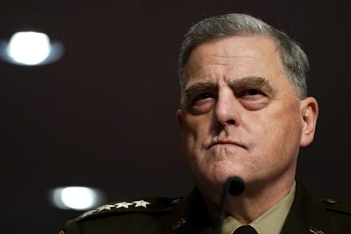 WASHINGTON, DC - SEP 28: Chairman of the Joint Chiefs of Staff Gen. Mark Milley listens to questions from Senators during a Senate Armed Services Committee hearing on the conclusion of military operations in Afghanistan and plans for future counterterrorism operations on Capitol Hill on Tues., Sept. 28, 2021 in Washington, DC. (Kent Nishimura / Los Angeles Times)