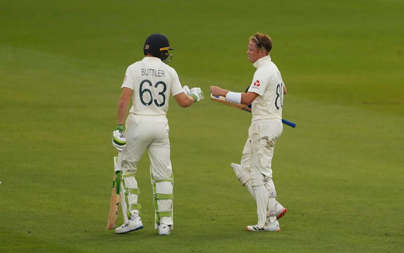 Jos Buttler and Ollie Pope - GETTY IMAGES