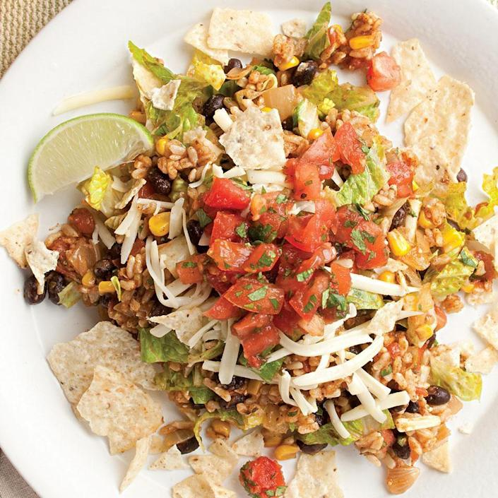 <p>Nobody will miss the meat in this colorful, zesty vegetarian taco salad. The rice and bean mixture can be made ahead and the salad quickly assembled at mealtime. Recipe by Nancy Baggett for EatingWell.</p>
