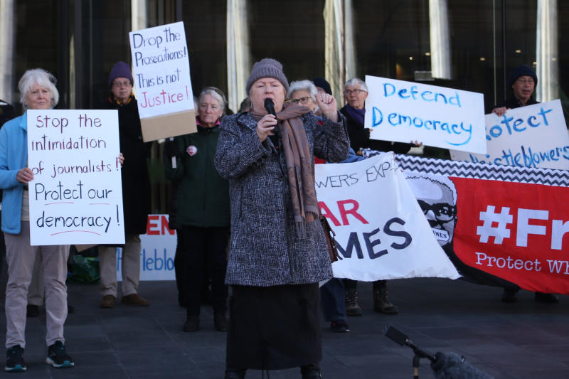 Free speech demonstrators rally outside the Australian Capital Territory Supreme Court in Canberra, Australia, on Thursday, Aug. 22, 2019. Two whistleblowers appeared in the court charged separately with leaking classified government information that alleges Australia bugged of East Timor's Cabinet and potential war crimes committed by Australian troops in Afghanistan. (AP Photo/Rod McGuirk)
