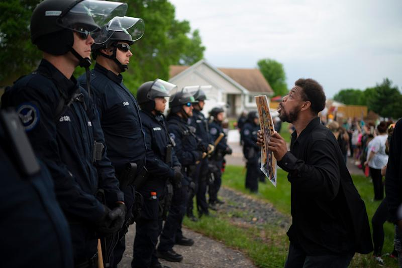 Protests in the Minneapolis area sparked by the death of George Floyd included one Wednesday evening outside the home of Derek Chauvin, the police officer who pinned the Black man to the ground with a knee of his neck. Chauvin and three other officers were quickly fired, but no charges have yet been filed in the case. (Photo: ASSOCIATED PRESS)
