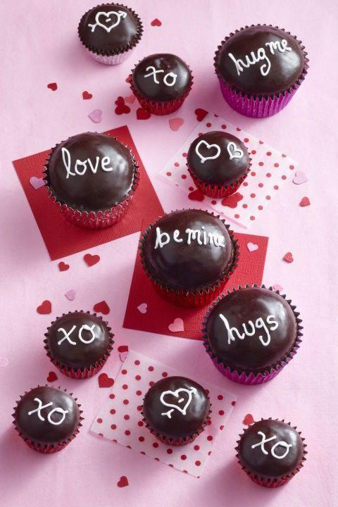 """<p>Write a short love note on each cupcake — something like """"Be mine"""" or """"ILY"""" — so that everyone gets a piece of your heart. </p><p><a href=""""https://www.womansday.com/food-recipes/food-drinks/recipes/a10541/chocolate-cupcakes-121992/"""" rel=""""nofollow noopener"""" target=""""_blank"""" data-ylk=""""slk:Get the recipe from Woman's Day »"""" class=""""link rapid-noclick-resp""""><em>Get the recipe from Woman's Day »</em></a></p>"""
