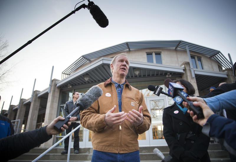 Illinois Republican gubernatorial primary candidate Bruce Rauner answers questions after voting on Tuesday, March 18, 2014, in Winnetka, Ill. Rauner faces State Sen. Bill Brady, State Sen. Kirk Dillard and State Treasurer Dan Rutherford in the primary election. (AP Photo/Andrew A. Nelles)