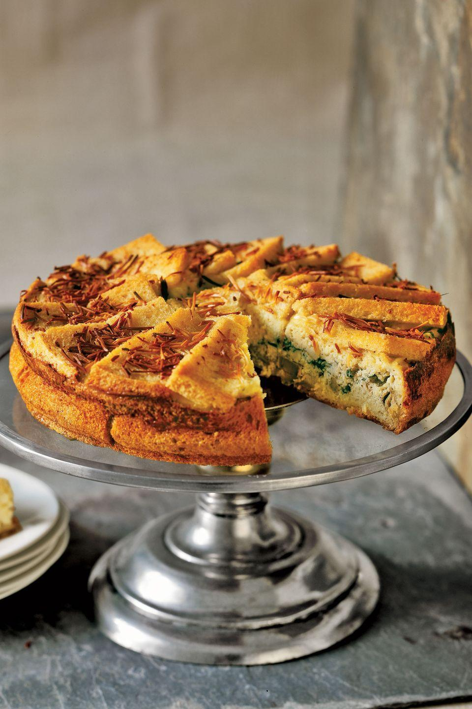 "Elegant eggs, served in this savory charlotte, begin with Fontina and ricotta cheeses, fresh basil and parsley, and thin slices of bread. The result is a melt-in-your-mouth meal, suitable for brunch or dinner. <a href=""https://www.countryliving.com/food-drinks/recipes/a779/fontina-herb-charlotte/"" rel=""nofollow noopener"" target=""_blank"" data-ylk=""slk:Get the recipe."" class=""link rapid-noclick-resp""><strong>Get the recipe.</strong></a>"