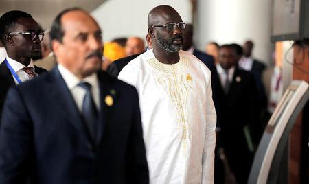 Liberia's President George Weah arrives at the 30th Ordinary Session of the Assembly of the Heads of State and the Government of the African Union in Addis Ababa