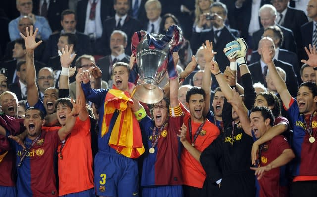 Carles Puyol, centre, won three Champions Leagues at Barcelona (Rebecca Naden/PA)