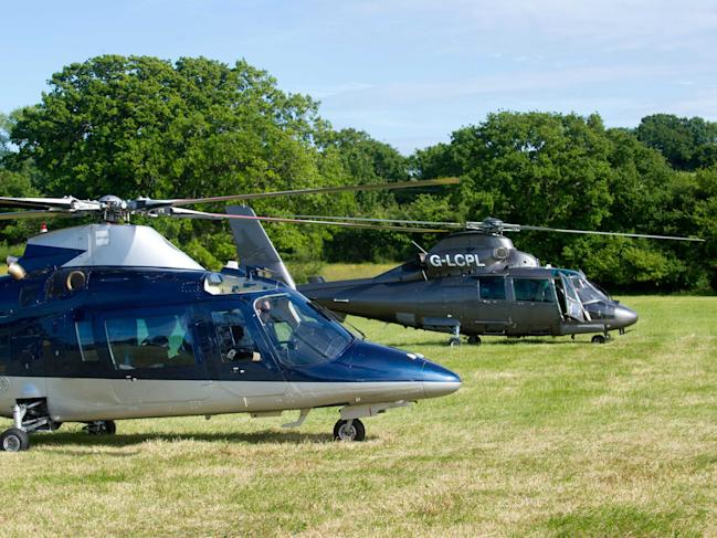 Bon Jovi arrive by helicopter at the Isle of Wight Festival at Seaclose Park in Newport, Isle of Wight.