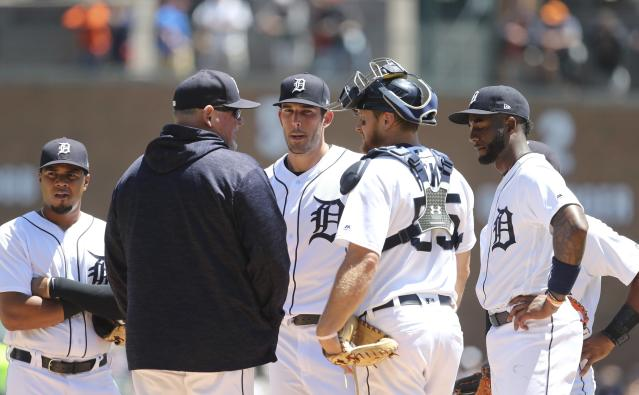FILE- In a June 4, 2018 file photo, Detroit Tigers pitching coach Chris Bosio talks with starting pitcher Drew VerHagen during the fourth inning of the first game of a baseball doubleheader against the New York Yankees, in Detroit. The Tigers have fired Bosio saying his contract was terminated for insensitive comments that were in violation of team policy and his contract. The team says it holds employees to the highest standards of personal conduct on and off the field, adding it has zero tolerance for Bosio's behavior. (AP Photo/Carlos Osorio, File)
