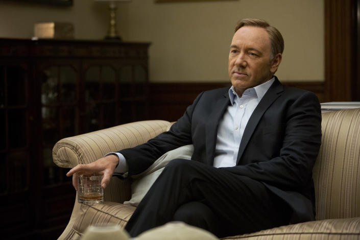 """This image released by Netflix shows Kevin Spacey in a scene from the Netflix original series, """"House of Cards,"""" an adaptation of a British classic. The program was nominated for an Emmy Award for outstanding drama series on, Thursday July 18, 2013. The Academy of Television Arts & Sciences' Emmy ceremony will be hosted by Neil Patrick Harris. It will air Sept. 22 on CBS. (AP Photo/Netflix, Melinda Sue Gordon)"""