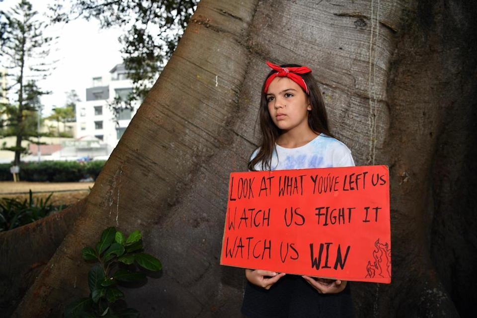 Teen activist Izzy Raj-Seppings poses for a photo outside Manly local court in Sydney.