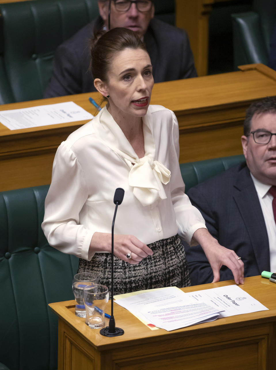 New Zealand's Prime Minister Jacinda Ardern moves a motion in the Parliament House in Wellington, New Zealand, to declare a climate emergency, Wednesday, Dec. 2, 2020. Joining more than 30 other countries around the world, New Zealand took the symbolic step of declaring a climate emergency. (Mark Mitchell/New Zealand Herald via AP)