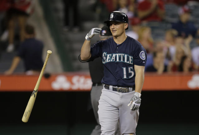 Seattle Mariners' Kyle Seager tosses his bat after striking out during the seventh inning of a baseball game against the Los Angeles Angels in Anaheim, Calif., Tuesday, June 18, 2013. (AP Photo/Jae C. Hong)