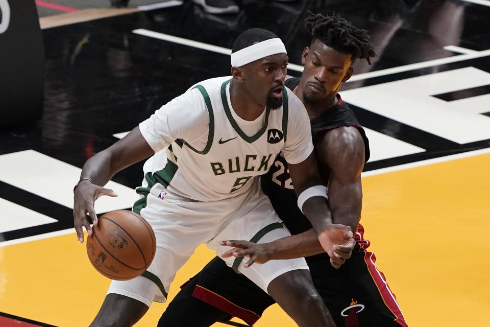 Miami Heat forward Jimmy Butler (22) defends against Milwaukee Bucks center Bobby Portis (9), during the second half of Game 3 of an NBA basketball first-round playoff series Thursday, May 27, 2021, in Miami. (AP Photo/Marta Lavandier)