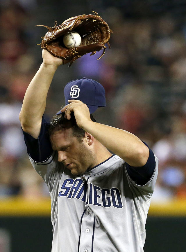 San Diego Padres' Eric Stults wipes his forehead after giving up another run, the sixth ofa baseball game, in the third inning against the Arizona Diamondbacks, Friday, July 26, 2013, in Phoenix. (AP Photo/Ross D. Franklin)
