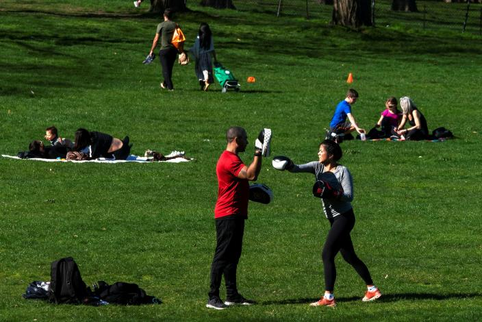 People try to keep a social distance while they enjoy a sunny day at Central Park, as the outbreak of coronavirus disease (COVID-19) continues, in the Manhattan borough of New York City, New York, U.S., April 6, 2020. REUTERS/Eduardo Munoz