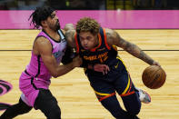Miami Heat guard Gabe Vincent (2) defends against Golden State Warriors guard Kelly Oubre Jr. (12) during the first half of an NBA basketball game, Thursday, April 1, 2021, in Miami. (AP Photo/Marta Lavandier)