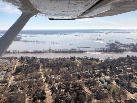 The Kansas side of the Missouri River is seen in Atchison, Kansas, U.S., March 22, 2019 in this picture obtained from social media. SHAWN RIZZA/via REUTERS