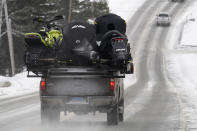 A truck carries snowmobiles, Saturday, Jan. 23, 2021, in Rangeley, Maine. Americans' desire to get outdoors during the pandemic despite the winter cold is creating a season unlike any in more than two decades for the snowmobiling industry. From Maine to Montana, it's becoming difficult to find a new snowmobile for sale AP Photo/Robert F. Bukaty)