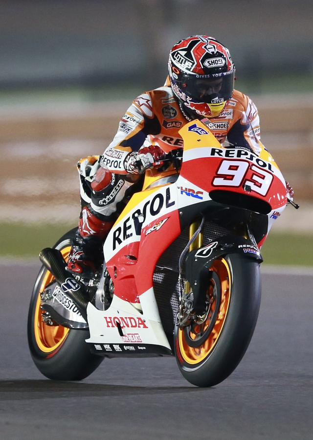 Honda MotoGP rider Marc Marquez of Spain rides his bike during a free practice session at the MotoGP World Championship at the Losail International circuit in Doha March 20, 2014. REUTERS/Mohammed Dabbous (QATAR - Tags: SPORT MOTORSPORT)