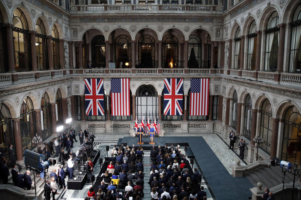 President Donald Trump and British Prime Minister Theresa May hold a news conference at the Foreign Office, Tuesday, June 4, 2019, in central London. (AP Photo/Alex Brandon)