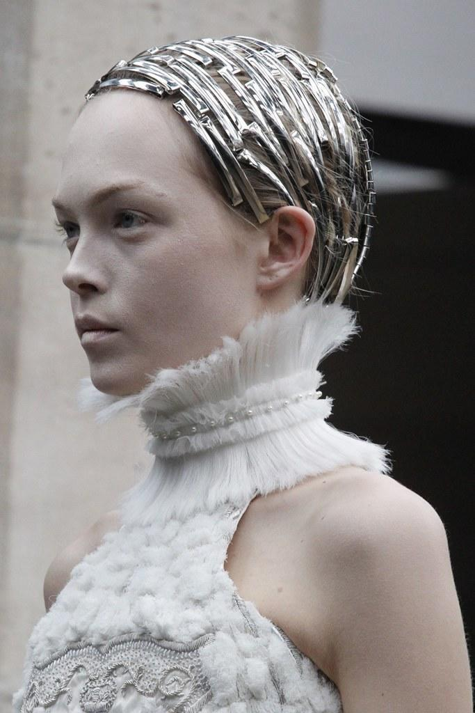 From ethereal white lashes to graphic sci-fi visors, a look back at the romantic beauty ideas on Sarah Burton's Alexander McQueen runway.
