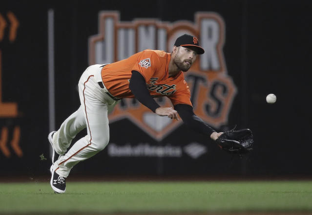 San Francisco Giants left fielder Mac Williamson makes a diving catch on a line drive from San Diego Padres' Clayton Richard during the seventh inning of a baseball game Friday, June 22, 2018, in San Francisco. (AP Photo/Marcio Jose Sanchez)