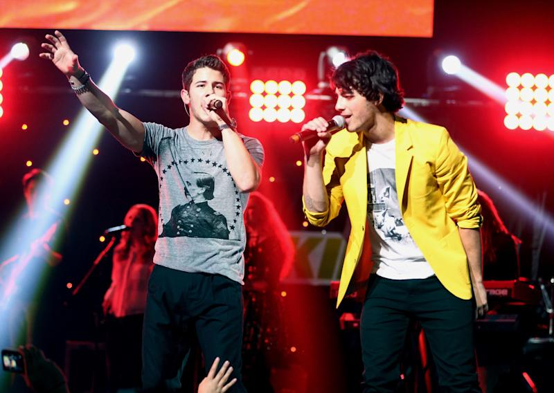 LOS ANGELES, CA - DECEMBER 01: Musicians Nick Jonas (L) and Joe Jonas of the Jonas Brothers perform onstage during KIIS FM's 2012 Jingle Ball at Nokia Theatre L.A. Live on December 1, 2012 in Los Angeles, California. (Photo by Christopher Polk/Getty Images for Clear Channel)
