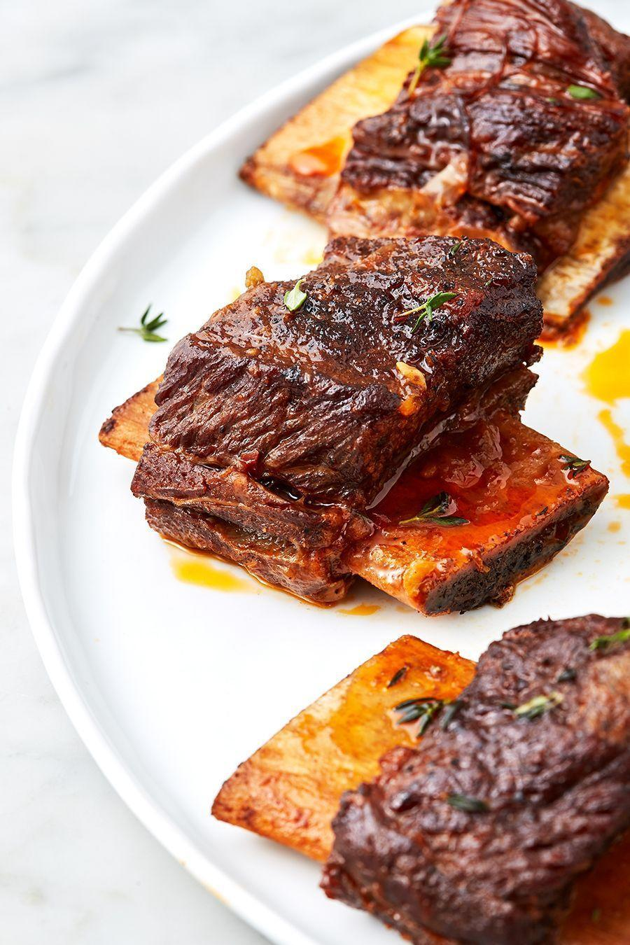 """<p>While not exactly instant, this Instant Pot recipe takes half the time most braised ribs recipes call for. The richness of bacon and short ribs shines against the mildly sweet background of sherry wine, carrots, and star anise. </p><p>Get the <a href=""""https://www.delish.com/uk/cooking/recipes/a31389371/instant-pot-short-ribs-recipe/"""" rel=""""nofollow noopener"""" target=""""_blank"""" data-ylk=""""slk:Instant Pot Short Ribs"""" class=""""link rapid-noclick-resp"""">Instant Pot Short Ribs</a> recipe.</p>"""