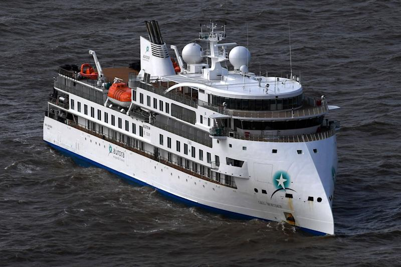 Aerial view of Australian cruise ship Greg Mortimer off the port of Montevideo on April 7, 2020. - Australian and New Zealand passengers on board a cruise ship off the South American coast will be the first flown home in a series of rescue flights as coronavirus on the ship rose sharply Tuesday, according to the Greg Mortimer's operator. Confirmed COVID-19 cases on the ship - currently anchored in the Rio de la Plata near Uruguay - jumped from 81 to 128 on Tuesday with a medical flight for the Australians onboard expected to begin Thursday. (Photo by PABLO PORCIUNCULA / AFP) (Photo by PABLO PORCIUNCULA/AFP via Getty Images)