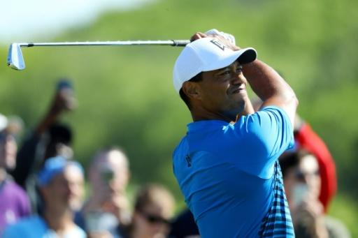 Tiger Woods of the United States plays his shot from the seventh tee during a practice round prior to the 2018 US Open at Shinnecock Hills Golf Club on June 12, 2018 in Southampton, New York