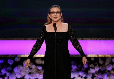 FILE PHOTO: Actress Carrie Fisher introduces her mother Debbie Reynolds as the recipient of the Life Achievement Award at the 21st annual Screen Actors Guild Awards in Los Angeles
